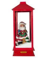 Singender Weihnachtsmann im Schnee